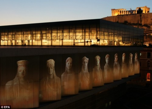 The 'Kores' statues are projected on the walls of the New Acropolis Museum in Athens under the temple of Parthenon